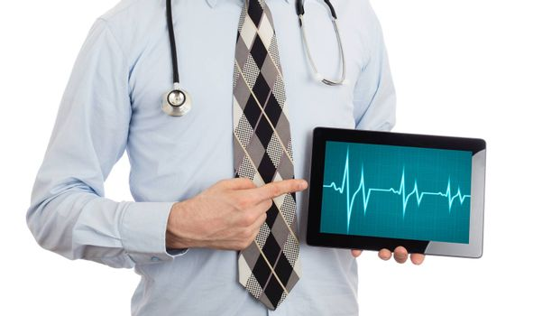 Doctor, isolated on white backgroun,  holding digital tablet - Heartbeat graph