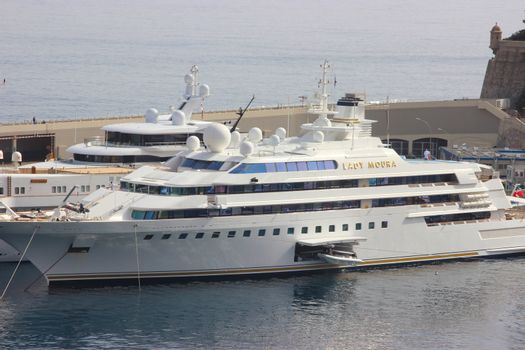 Monte-Carlo, Monaco - April 6, 2016: Luxury Yacht in the Port Hercule of Monaco. Lady Moura is a Private Luxury Yacht. The Owner is a Wealthy Saudi Arabian Businessman, Nasser Al-Rashid