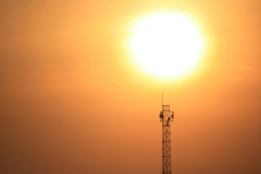 Silhouette of communication antenna in a woderful orange sunset