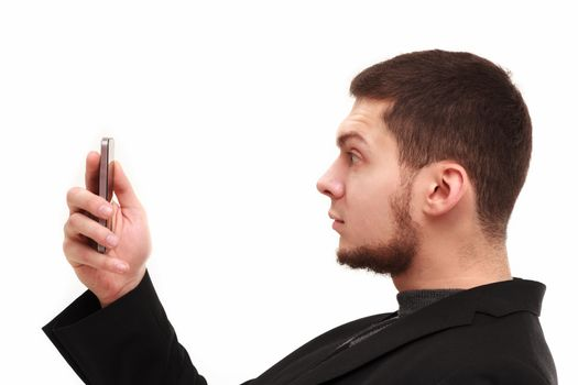 Casual businessman surprisedly looking  at his phone screen isolated on white