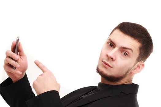Casual businessman pointing with a finger at the phone with a raised eyebrow
