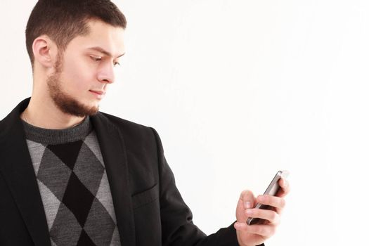 Casual businessman using his phone isolated on white