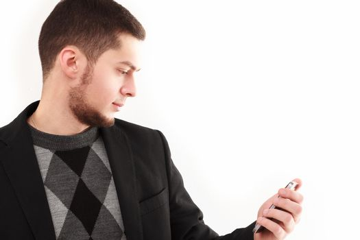 Casual businessman looking  at his phone screen isolated on white