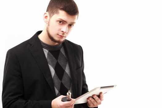 Casual businessman using his tablet and e-cigarette isolated on white looking in camera