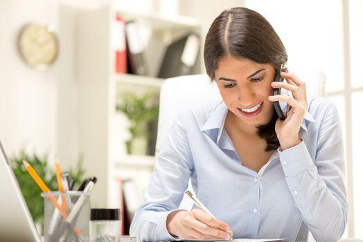 Happy Businesswoman Phoning
