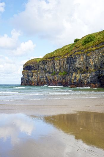 lone kayaker near the cliffs of ballybunion beach on the wild atlantic way ireland