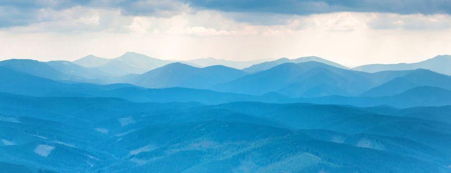 Blue mountains. Panorama view of peaks ridge