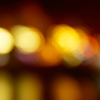Blur abstract orange holiday lights can be used for background