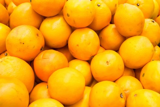 Pile of fresh oranges and mandarins at market