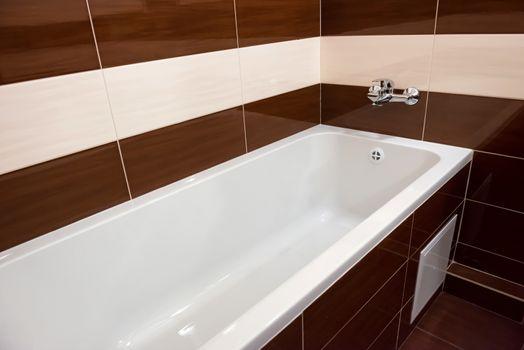 White luxury bathtub in bathroom with ceramic interior