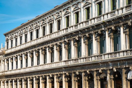 Facade of white Doge's Palace on Piazza San Marco (Saint Mark square) in Venice