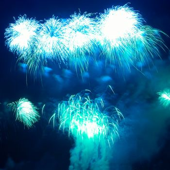 Colorful blue fireworks on the black sky background