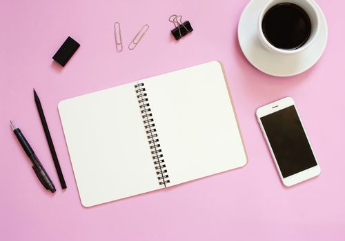 Creative flat lay mockup design of workspace desk with blank notebook, smartphone, coffee, stationery with copy space background