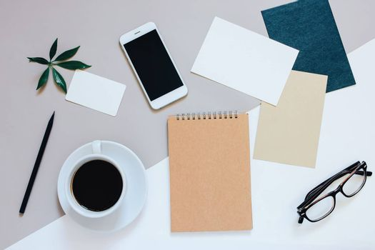 Creative flat lay photo of workspace desk with smartphone, coffee, tag, letter and notebook with copy space background, minimal style