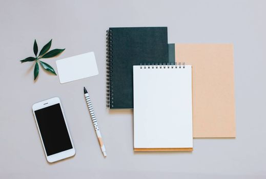 Creative flat lay photo of workspace desk with smartphone, coffee and notebook with copy space background, minimal style