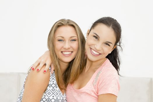 Two beautiful and happy teenage friends in the school