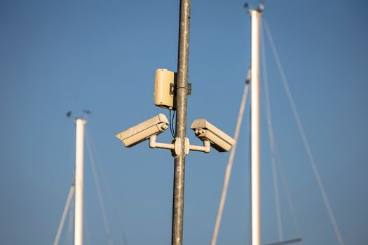 Security cameras in yachting harbor