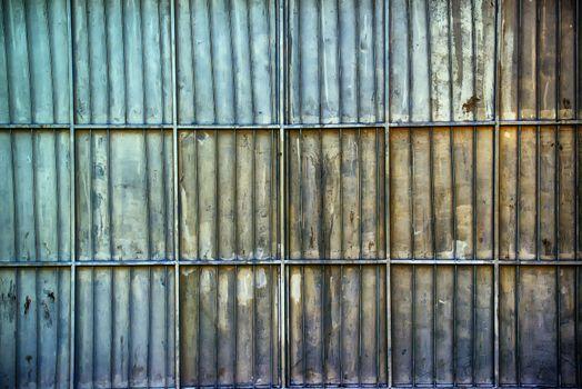 Rusty aluminum metal platted garage wall