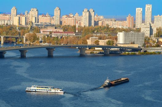 Boats on the Dnieper River near the bridge floats in Kiev in summer day