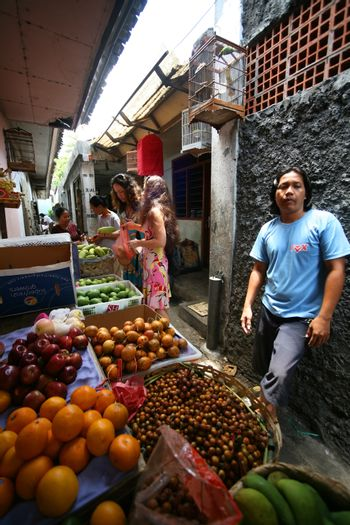 Bali, Indonesia - October 24, 2007: Residents of Bali are selling fruit on the open market on the streets of Bali. Indonesia