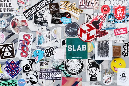 Bumper stickers and graffiti on the street