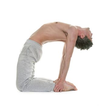 man doing yoga in front of white background