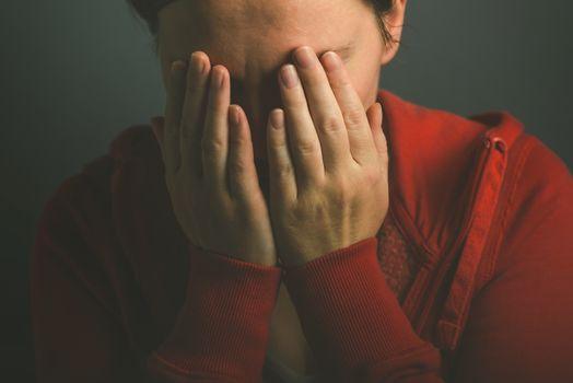 Sorroful woman crying in despair