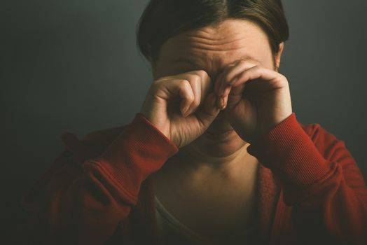 Woman crying in despair