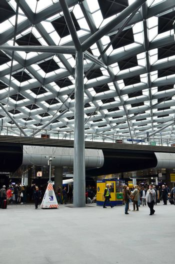 The Hague, Netherlands - May 8, 2015: Travelers at central Station of The Hague, Netherlands on May 8, 2015. The station is the largest railway station in The Hague.