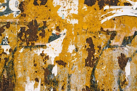 Corroded metal plate texture and poster paper scraps