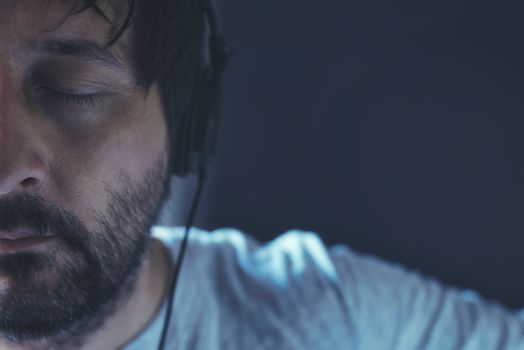 Man listening to music with eyes closed