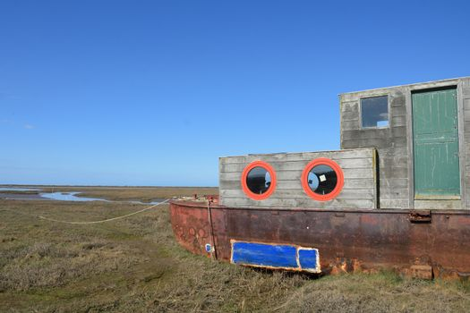 Rusty  old Houseboat overlooking estuary
