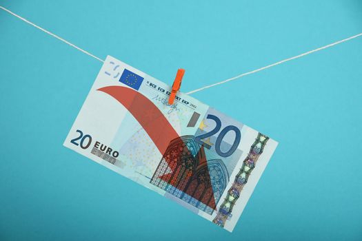 Euro decline illustrated over blue