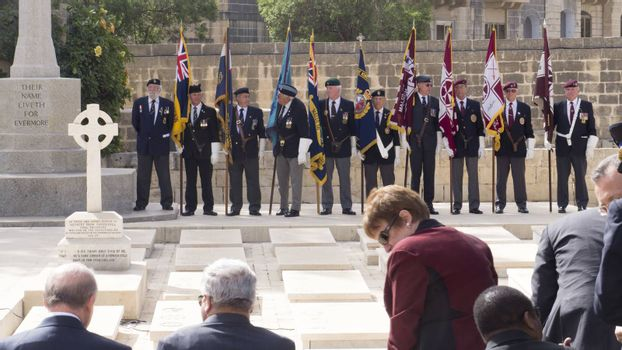 MALTA, Marsa: Veterans stand bearing the flags at the memorial for Anzac Day on April 25, 2016, in Malta.The Wreath laying ceremony takes place on the anniversary of the first major military action fought by Australian and New Zealand forces during World War I. Thousands of woundedAustralians, New Zealanders, Canadians and English were sent to the tiny Mediterranean island for care during theGallipolicampaign. ANZAC stands for Australian and New Zealand Army Corps.