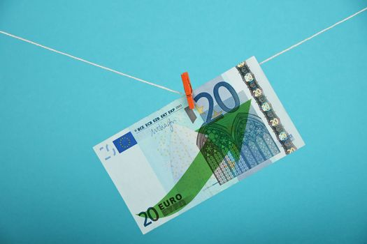 Euro currency growth illustrated over blue