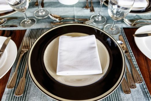 Neat dining table setting in front of plate