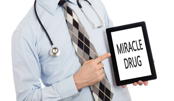 Doctor, isolated on white backgroun,  holding digital tablet - Miracle drug