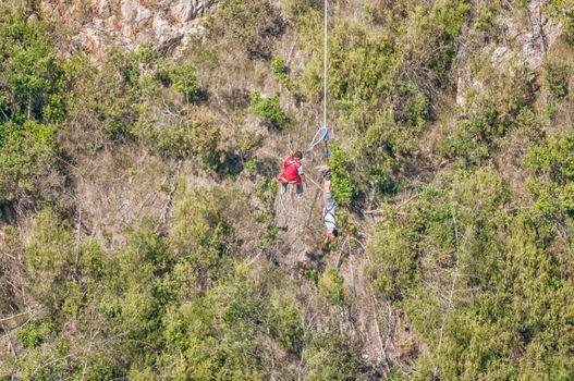 Hoisting bungee jumper at Bloukrans Bridge