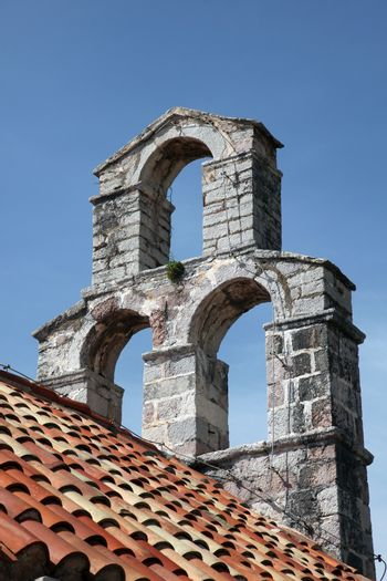 The bell tower of the church of Saint Mary in Punta, Budva, Montenegro