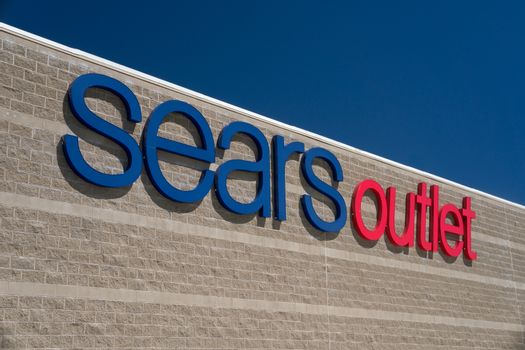 PALMDALE, CA/USA - APRIL 23, 2016: Sears Outlet exterior sign. Sears is an American department store chain and fourth largest U.S. department store company by retail sales.