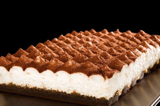 Delicious tiramisu dessert isolated. Traditional italian sweet dessert.