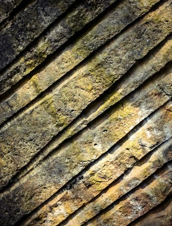 sandstone rock with grooves