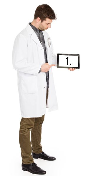 Doctor holding tablet, isolated on white - Number 1