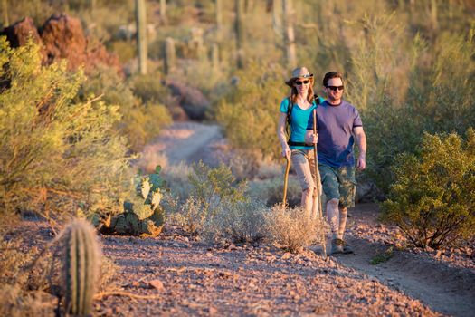 Two Afternoon Hikers on Rugged Desert Trail
