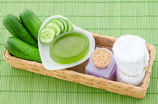 shampoo bottle with cucumber and towel.