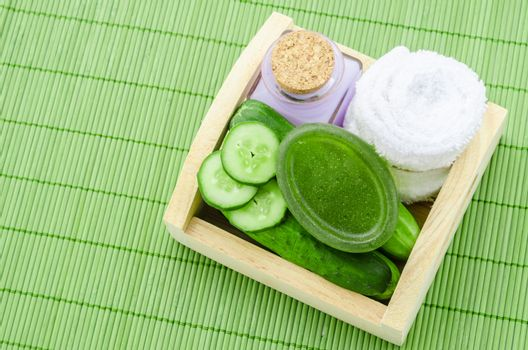 shampoo bottle with cucumber and towel