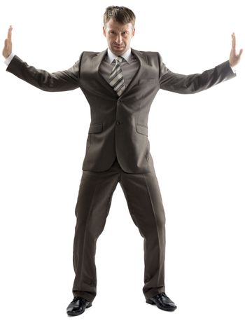 Business man stretching his arms to sides