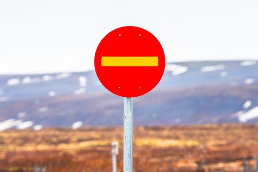 Stop sign in highland landscape