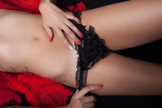 Provocative girl in black lace panties