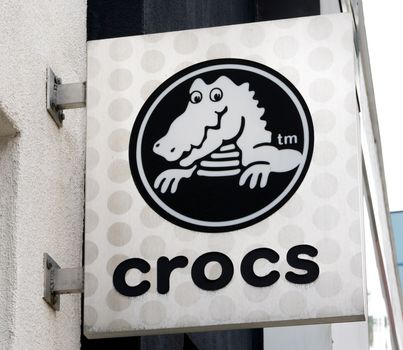 SANTA MONICA, CA/USA - MAY 12, 2016: Crocs sign and logo. Crocs, Inc. is a shoe manufacturer that produces and distribute foam clog footwear.